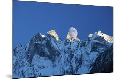 The Moon Appears Behind the Snowy Mountains Illuminating the Peaks-Roberto Moiola-Mounted Photographic Print