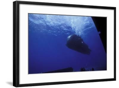 A Seal Delivery Vehicle Drives by the Dry Deck Shelter Outer Hangar Door-Stocktrek Images-Framed Photographic Print