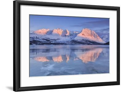 Snowy Peaks are Reflected in the Frozen Lake Jaegervatnet at Sunset, Lapland-Roberto Moiola-Framed Photographic Print