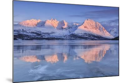 Snowy Peaks are Reflected in the Frozen Lake Jaegervatnet at Sunset, Lapland-Roberto Moiola-Mounted Photographic Print
