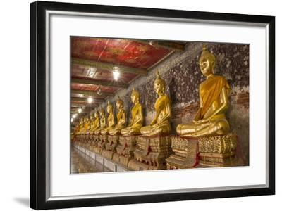 Rows of Gold Buddha Statues, Wat Suthat Temple, Bangkok, Thailand, Southeast Asia, Asia-Stephen Studd-Framed Photographic Print