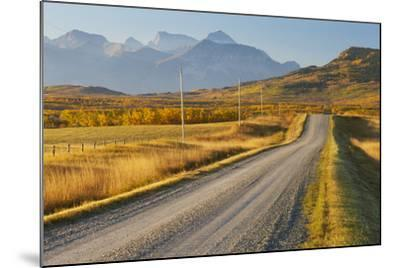 Country Road Through a Mountainous Landscape, Near Twin Butte, Alberta, Canada, North America-Miles Ertman-Mounted Photographic Print
