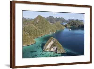 Forest-Covered Limestone Islands Surround a Lagoon in Raja Ampat-Stocktrek Images-Framed Photographic Print