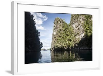 Rugged Limestone Islands Frame an Indonesian Pinisi Schooner-Stocktrek Images-Framed Photographic Print