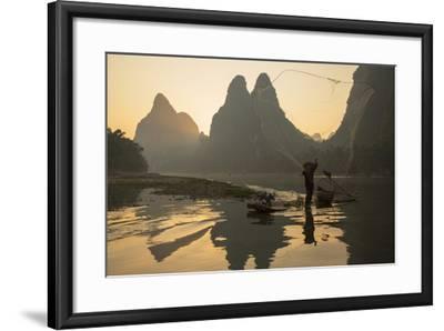 Cormorant Fisherman Throwing Net on Li River at Dawn, Xingping, Yangshuo, Guangxi, China-Ian Trower-Framed Photographic Print