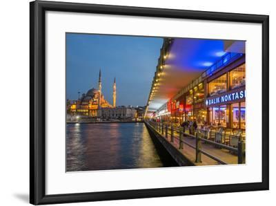 Outdoor Restaurants under Galata Bridge with Yeni Cami or New Mosque at Dusk, Istanbul-Stefano Politi Markovina-Framed Photographic Print