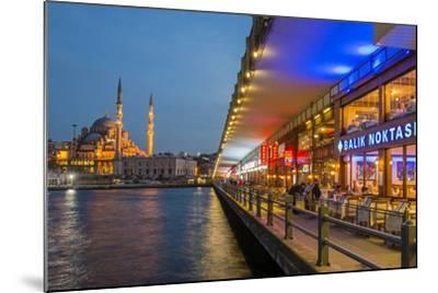 Outdoor Restaurants under Galata Bridge with Yeni Cami or New Mosque at Dusk, Istanbul-Stefano Politi Markovina-Mounted Photographic Print
