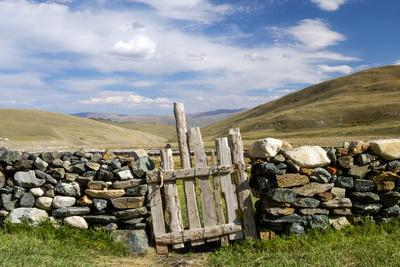 Asia, Western Mongolia, Bayan Olgii Province, Gashuun Suhayt. Stone Fence with Wooden Gate-Emily Wilson-Framed Photographic Print