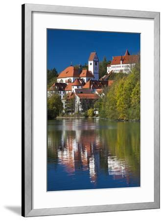 Germany, Bavaria, Fussen, St. Mang Abbey and the Hohes Schloss Castle from the Lech River-Walter Bibikow-Framed Photographic Print