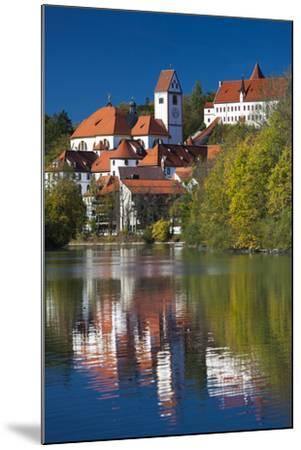 Germany, Bavaria, Fussen, St. Mang Abbey and the Hohes Schloss Castle from the Lech River-Walter Bibikow-Mounted Photographic Print