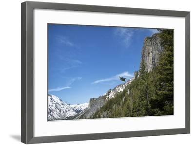 A Wingsuit Pilot Flying Near a Mountain-Chad Copeland-Framed Photographic Print