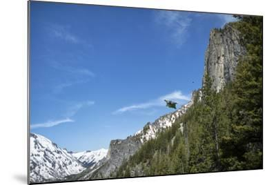 A Wingsuit Pilot Flying Near a Mountain-Chad Copeland-Mounted Photographic Print