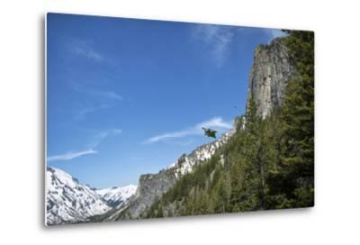 A Wingsuit Pilot Flying Near a Mountain-Chad Copeland-Metal Print
