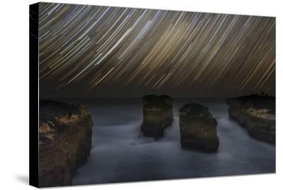 Time-Exposure of Star Trails Above the Shore of Southern Ocean in Victoria, Australia-Babak Tafreshi-Stretched Canvas Print