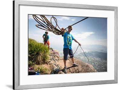 Young Man Standing on Top of the Mountain Holding Rope for Slacklining-Keith Ladzinski-Framed Photographic Print