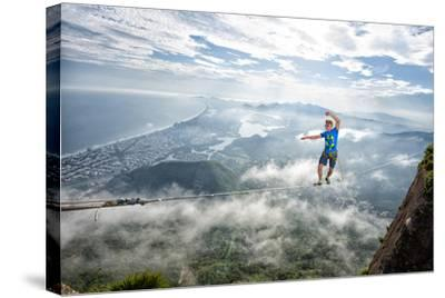 A Highliner Traverses Two Cliffs Above Rio De Janeiro-Keith Ladzinski-Stretched Canvas Print