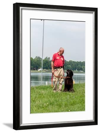 A Newfoundland Dog Trained for Rescue at Sea, with an Instructor at a Lake Near Milan-Lori Epstein-Framed Photographic Print