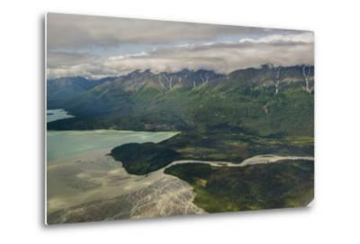 A River Muddy with Glacial Silt Pours into the Blue-Green Waters of Lake Clark-Beth Wald-Metal Print