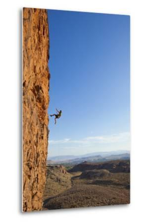 A Male Rock Climber Rappelling in Snow Canyon State Park-John Burcham-Metal Print
