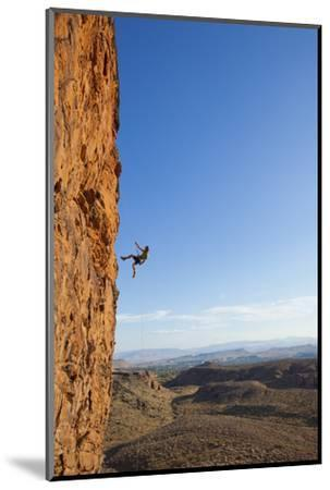 A Male Rock Climber Rappelling in Snow Canyon State Park-John Burcham-Mounted Photographic Print