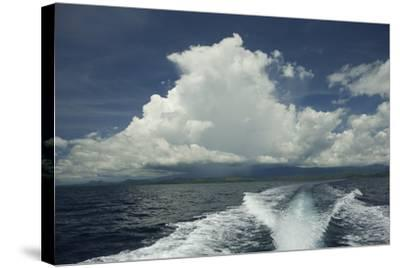 Rain Clouds over the Village of Labilabi on Halmahera Island-Timothy Laman-Stretched Canvas Print