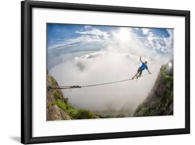 A Coastal Front Blows in While a Highliner Traverses Two Cliffs Above Rio De Janeiro-Keith Ladzinski-Framed Photographic Print