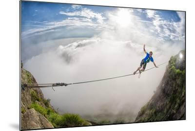 A Coastal Front Blows in While a Highliner Traverses Two Cliffs Above Rio De Janeiro-Keith Ladzinski-Mounted Photographic Print