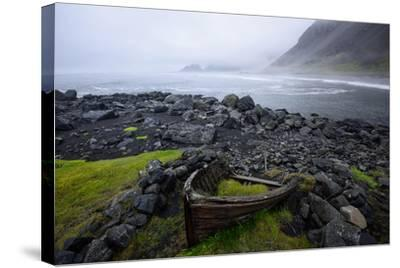 The Wreck of a Boat Rests on Stokeness Beach in Hofn, Iceland-Keith Ladzinski-Stretched Canvas Print