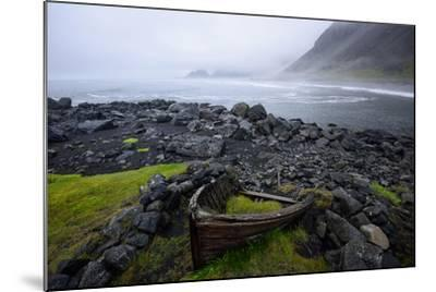 The Wreck of a Boat Rests on Stokeness Beach in Hofn, Iceland-Keith Ladzinski-Mounted Photographic Print