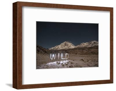 """A Time Exposure of the Word """"Wild"""" Written Beneath the Peak of Mount Everest-Max Lowe-Framed Photographic Print"""