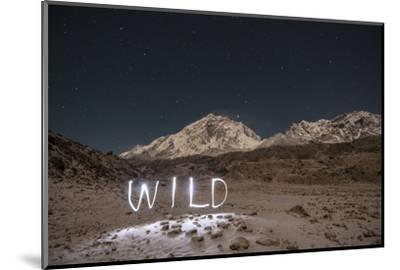 """A Time Exposure of the Word """"Wild"""" Written Beneath the Peak of Mount Everest-Max Lowe-Mounted Photographic Print"""