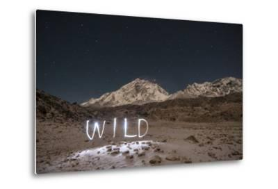 """A Time Exposure of the Word """"Wild"""" Written Beneath the Peak of Mount Everest-Max Lowe-Metal Print"""