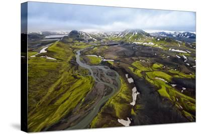 An Aerial of a Rolling Green Landscape and Streams of Glacier Runoff at Southern Iceland-Keith Ladzinski-Stretched Canvas Print