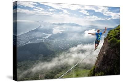 A Highliner Traverses Two Cliffs Above Rio De Janeiro-Keith Ladzinski-Stretched Canvas Print