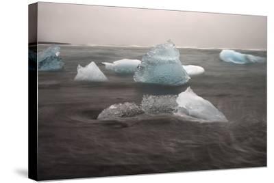 Icebergs on Black Sand Beach-Raul Touzon-Stretched Canvas Print