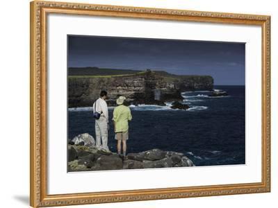 Tourists Looking at the Sea Cliffs of Espanola Island-Jad Davenport-Framed Photographic Print