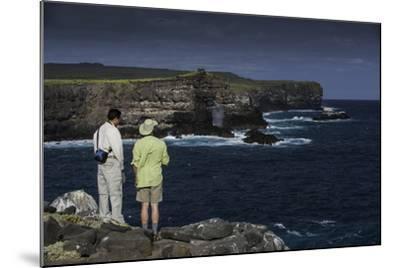 Tourists Looking at the Sea Cliffs of Espanola Island-Jad Davenport-Mounted Photographic Print