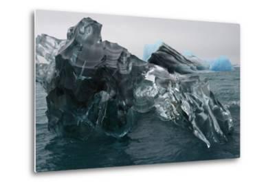 A Large Block of Sculptured Ice Floating on Jokulsarlon Lagoon-Raul Touzon-Metal Print