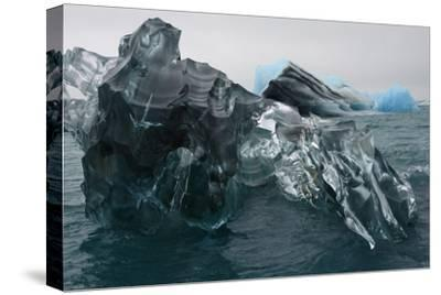 A Large Block of Sculptured Ice Floating on Jokulsarlon Lagoon-Raul Touzon-Stretched Canvas Print