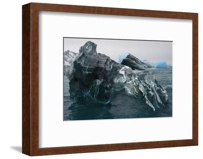 A Large Block of Sculptured Ice Floating on Jokulsarlon Lagoon-Raul Touzon-Framed Photographic Print