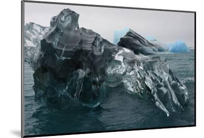 A Large Block of Sculptured Ice Floating on Jokulsarlon Lagoon-Raul Touzon-Mounted Photographic Print