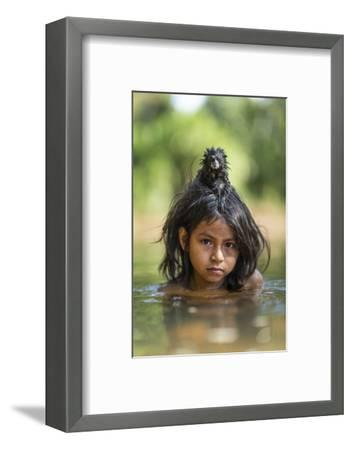 A Pet Saddleback Tamarin Hangs on Tight to a Matsigenka Girl as She Swims in the Yomibato River-Charlie Hamilton James-Framed Photographic Print