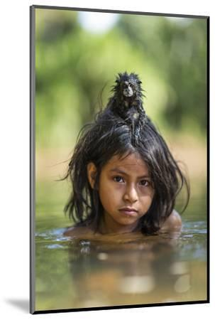 A Pet Saddleback Tamarin Hangs on Tight to a Matsigenka Girl as She Swims in the Yomibato River-Charlie Hamilton James-Mounted Photographic Print