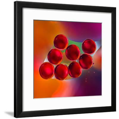 Macro of Red Engine Oil Drops on Water Surface with Colorful Blured Background- Abstract Oil Work-Framed Photographic Print