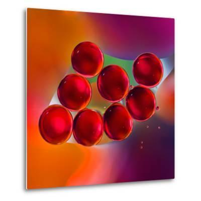 Macro of Red Engine Oil Drops on Water Surface with Colorful Blured Background- Abstract Oil Work-Metal Print