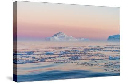 Stunning Iceberg Landscape with Midnight Sun Colors at Mouth ofIcefjord, Near Ilulissat, Greenland-Luis Leamus-Stretched Canvas Print