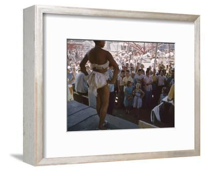 Audience Gathers to Watch a Dancer in a Two-Piece Costume at the Iowa State Fair, 1955-John Dominis-Framed Photographic Print