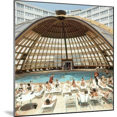Dome over Swimming Pool as Guests are Served Cocktails at International Inn, Washington DC, 1963-Yale Joel-Mounted Photographic Print