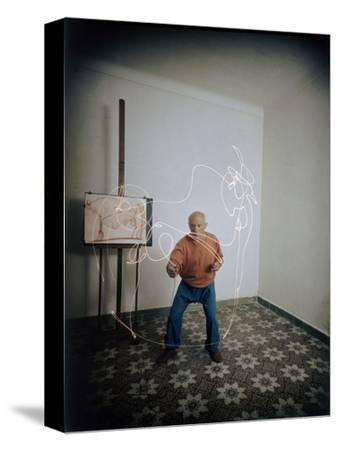 Artist Pablo Picasso Attempting to Draw a Minotaur Using Light Pen, Vallauris, France, 1949-Gjon Mili-Stretched Canvas Print