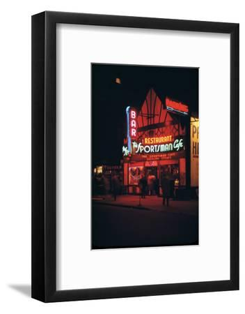 1945: Neon Lights Outside the Sportsman Cafe on 236 West 50th Street at Night, New York, NY-Andreas Feininger-Framed Photographic Print